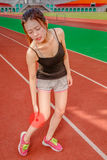 Chinese jogger with injured leg, throbbing pain Royalty Free Stock Photos
