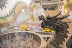 Chinese joss stick pot and dragon statue at Hyuaplakang temple ,Thailand Royalty Free Stock Photo
