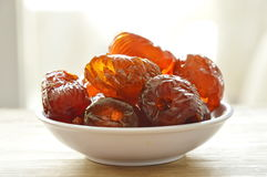 Chinese jujube candy on cup Royalty Free Stock Photography