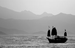 Chinese Junk. Black & White Chinese Junk in Hong Kong Harbour Royalty Free Stock Photo