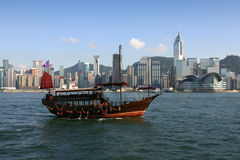 Chinese junk. View across Victoria Harbour complete with traditional Chinese junk in the foreground Stock Photography
