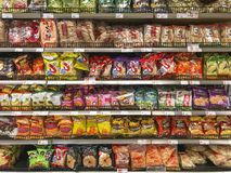 Chinese junk food on display. DEN HAAG, 31 December 2017 - Display of the Chinese junk food, packs of chips in the supermarket, The Netherlands Stock Photo
