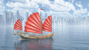 Chinese junk ship and city by the sea Stock Photo