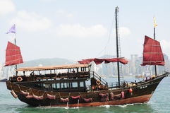 Chinese junk in Victoria harbour in Hong Kong. This Chinese junk is one of the few that still sails around Hong Kong harbour Stock Photography