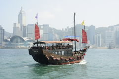 Chinese junk in Victoria harbour in Hong Kong. This Chinese junk is one of the few that still sails around Hong Kong harbour Royalty Free Stock Images