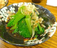 Chinese kale with dried bonito flakes Stock Images