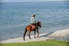 Chinese Kazakh herdsmen  riding  horse at Sailimu  Stock Image