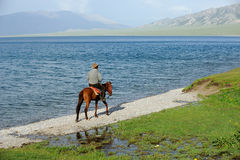 Chinese Kazakh herdsmen  riding  horse at Sailimu  Royalty Free Stock Photography