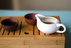 Chinese kettle and cups on the table. stock photo