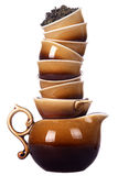 Chinese kettle and tea cups. A stack of Chinese kettle and tea cups royalty free stock photography