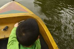 Kid driving boat stock images