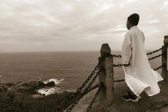 Chinese kid lookout sea wearing white robe royalty free stock photography