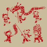 Chinese kids celebrating new year coming. Chinese paper-cutting art: Kids playing dragon dance, lion dance and firecrackers to celebrate the Chinese new year Royalty Free Stock Photo