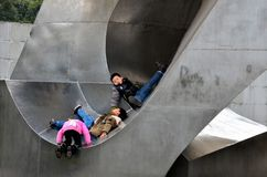 Chinese kids play in outdoor metal sculpture, Shanghai China Royalty Free Stock Image