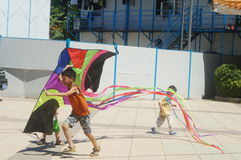 Chinese kids are playing a kite Royalty Free Stock Images