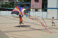 Chinese kids are playing a kite Stock Images