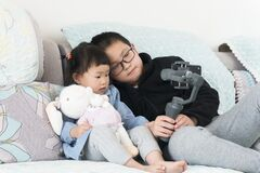 Chinese Kids Selfie With Gimbal At Home Royalty Free Stock Image