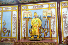 Chinese King, Emperor, Ruler, Royalty. A Chinese king, emperor, or ruler stands at his throne. Royal royalty royalty free stock photography
