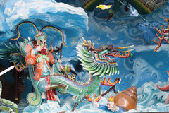 Chinese King Neptune Riding Dragon Diorama. SINGAPORE - FEBRUARY 1, 2014: Neptune Riding Dragon in the Eight Immortals Invading Neptune Palace Diorama at Haw Par Royalty Free Stock Images