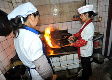Chinese kitchen. Cook making a dinner in local restaurant in Xining, western China Stock Images