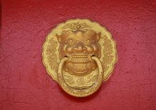 Chinese knocker. Asian doors opening with its protective gargoyles which also serve as knockers and handles Royalty Free Stock Images