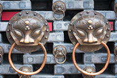 Chinese knockers on a wall Stock Images