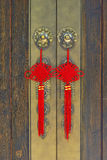 Chinese knot. A pair of Chinese knot hooks on a door Royalty Free Stock Image