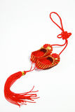 Chinese knot. On the white background Royalty Free Stock Photo