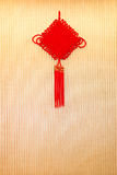 Chinese knot a good luck symbol hanging. On wall royalty free stock photography