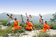 Chinese Kung Fu. Shaolin monks who performs the Chinese KungFu on the mountain Stock Image
