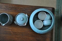 Chinese Kung Fu Tea Set. Five cups of tea and a ceramic pot royalty free stock image