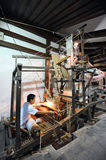 Chinese laborers weave silk Stock Photography