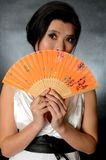 Chinese lady with fan Stock Photo