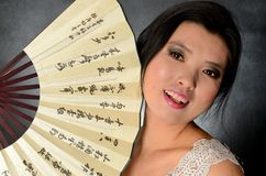 Chinese lady with fan Royalty Free Stock Photo