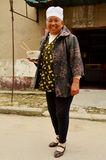 Chinese Lady by Home with Lunch Bowl, Kaifeng Royalty Free Stock Photo