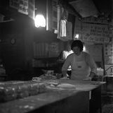 Chinese lady preparing dumplings in the kitchen of a restaurant in Taiwan, shot with analogue black and white film royalty free stock photos