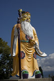 Chinese Land Goad. This is a statue of a Chinese land God.  He's holding a gold ingot, and wearing a traditional Chinese custome, with symbols on it. He's big Royalty Free Stock Photo