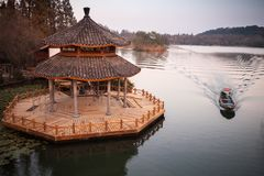 Wooden gazebo on coast of West Lake Stock Photo