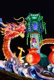 Chinese lantern festival. Colorful lanterns featuring a dragon as well as other significant objects in lights against a night sky, in celebration of the Chinese Royalty Free Stock Photos