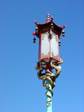 Chinese lantern lamppost. Chinatown lamppost with golden dragon details Stock Photo