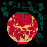 Chinese Lantern on tree. Oriental lantern decorated with floral patterns hang on tree Red on black background Stock Images