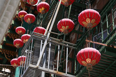 Chinese Lanterns. Red and gold Chinese lanterns hanging from a building in San Francisco Chinatown, the oldest and largest Chinatown in the United States Royalty Free Stock Images