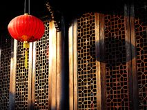 Chinese lanterns. Red  lanterns in front of  traditional chinese architecture windows Stock Photography