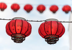 Chinese lanterns hanging, with a white sky behind them Royalty Free Stock Photo