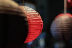 Chinese lanterns hung in a row. Red and black paper lanterns hung from the ceiling as party decorations Royalty Free Stock Photography