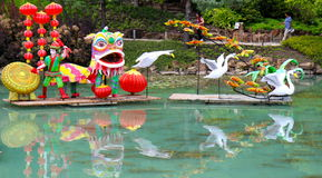 Chinese lanterns on pond Stock Images