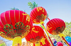 Chinese lanterns in red fabric with golden ornaments Stock Images