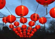 Chinese lanterns. Rows of glowing Chinese lanterns at dusk Royalty Free Stock Photo