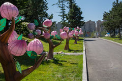 Chinese lanterns stylized as a trees along pavement. Royalty Free Stock Photo