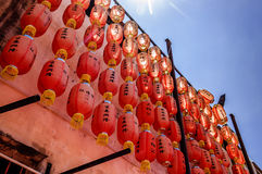 Chinese lanterns in temple, Penang, Malaysia. Penang, Malaysia - September 3, 2013: Hanging Chinese lanterns glowing in sunlight at Hok Teik Cheng Sin Chinese royalty free stock image